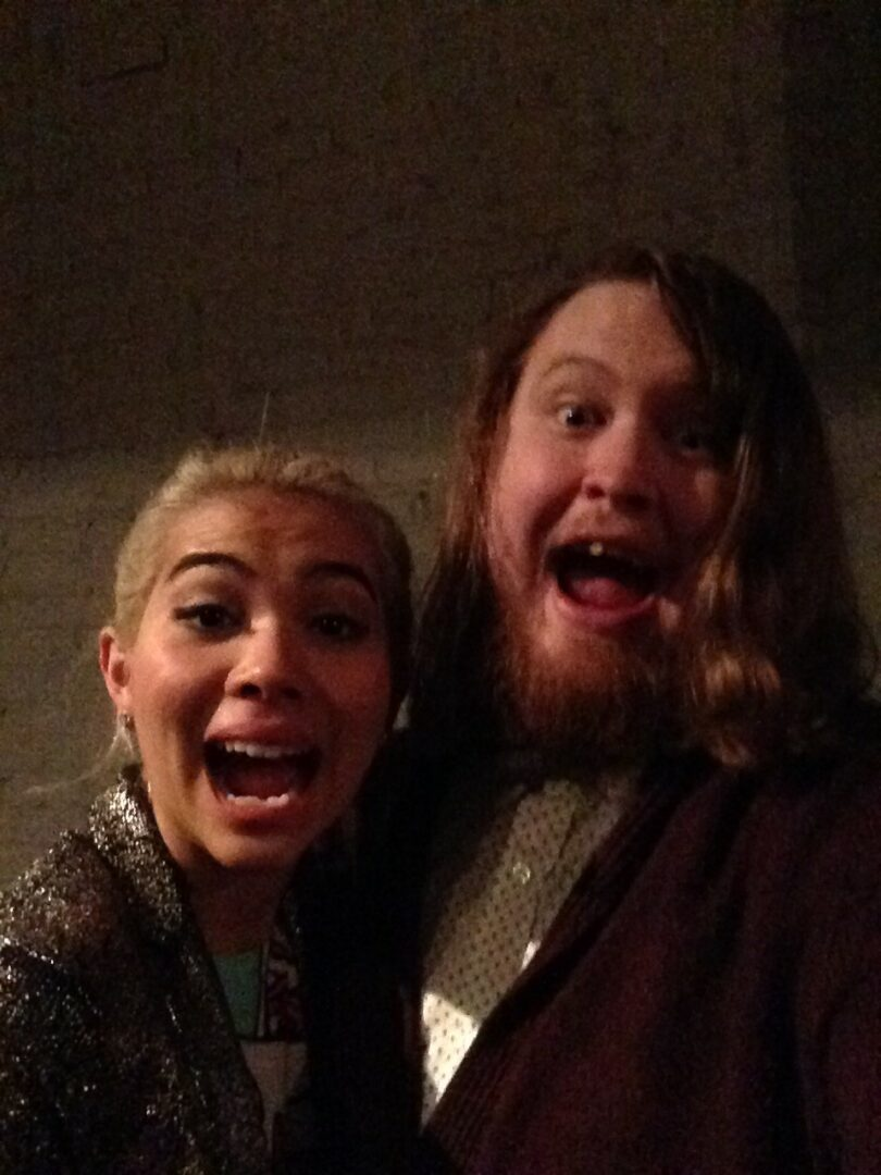 Hayley Kiyoko and Luke Sheafer take a selfie behind the mercy booths after Never Shout's set in Lansing.